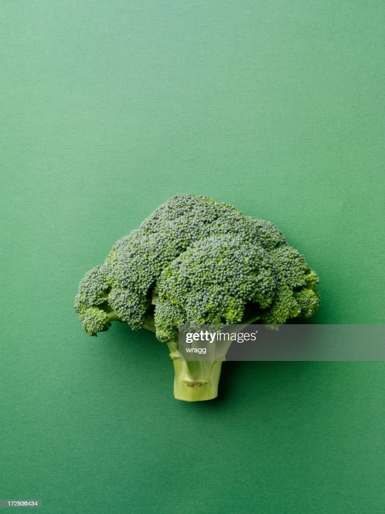 Broccoli on a Green Background : Stock Photo