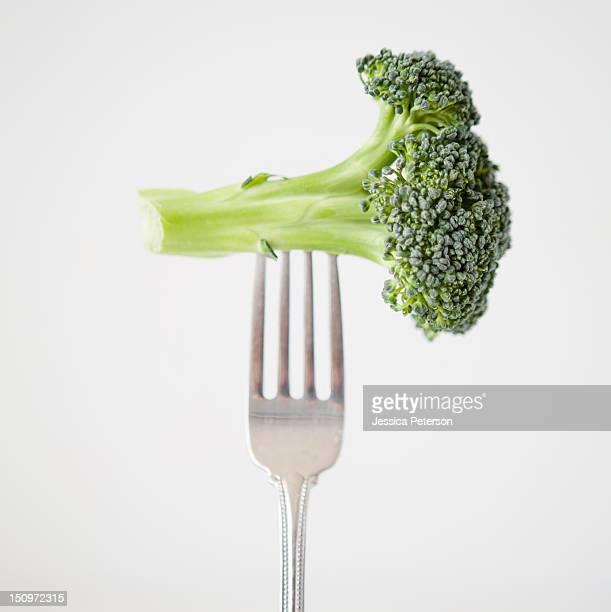 Broccoli on fork, studio shot