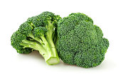 Picture of fresh cut broccoli. Broccoli is brightly illuminated and photographed against white background.