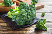 Healthy green organic raw broccoli on wooden table