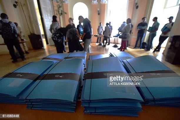 Brochures of the Central European University in Budapest are seen as refugee students arrive on their first day of study on September 17 2016 CEU is...