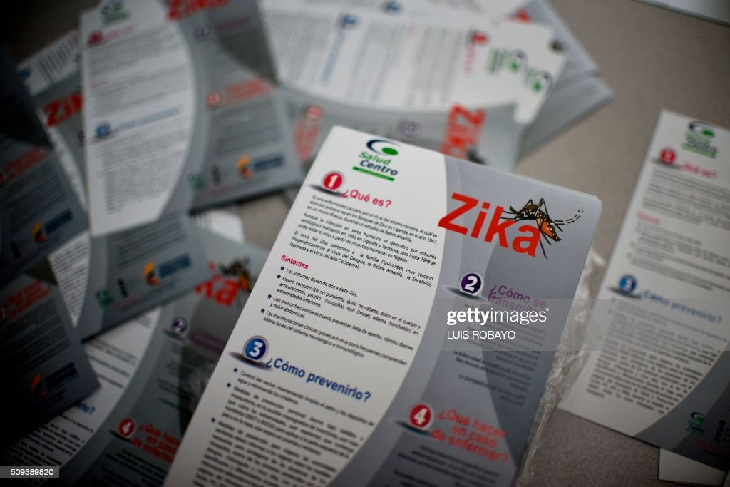 Brochures with information about the Zika virus are seen on February 10, 2016, in Cali, Colombia. The Colombian Health Ministry began delivering mosquito nets for free to pregnant women to prevent the infection by Zika virus, vectored by the Aedes aegypti mosquito. The World Health Organization on Tuesday urged caution about linking the Zika virus with a rare nerve disorder called Guillain-Barre which health officials in Colombia have blamed for three deaths. AFP PHOTO / LUIS ROBAYO / AFP / LUIS ROBAYO