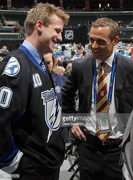 Brock Beukeboom drafted in the third round by the Tampa Bay Lighting talks with general manager Steve Yzerman during day two of the 2010 NHL Entry...