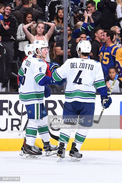 Brock Boeser and Michael Del Zotto of the Vancouver Canucks celebrate during a game against the Los Angeles Kings at STAPLES Center on September 16...