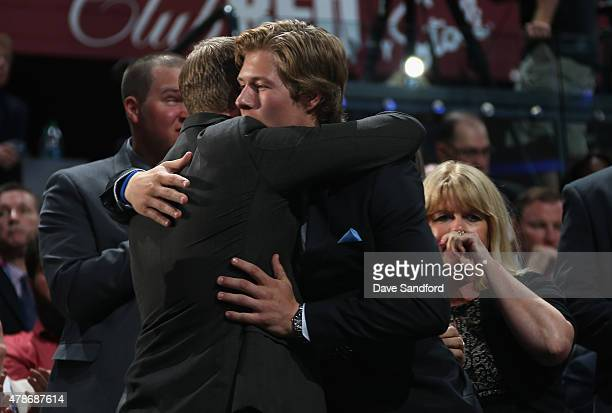Brock Boeser celebrates after being selected 23rd overall by the Vancouver Canucks during Round One of the 2015 NHL Draft at BBT Center on June 26...