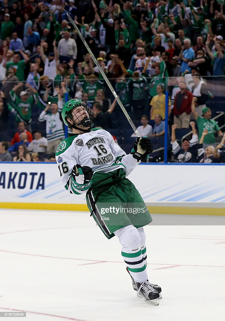 Brock Boeser #16 of the North Dakota Fighting Hawks celebrates his empty net goal in the third period against the Denver Pioneers during semifinals of the 2016 NCAA Division I Men's Hockey Championships at Amalie Arena on April 7, 2016 in Tampa, Florida.