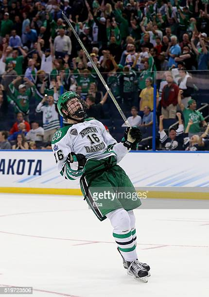 Brock Boeser of the North Dakota Fighting Hawks celebrates his empty net goal in the third period against the Denver Pioneers during semifinals of...