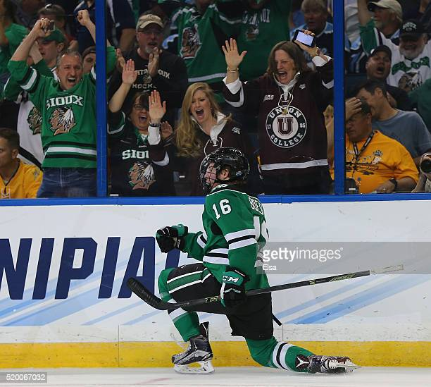 Brock Boeser of the North Dakota Fighting Hawks celebrates his goal in the first period against the Quinnipiac Bobcats during the championship game...