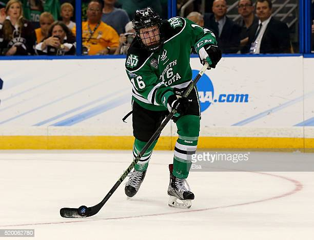 Brock Boeser of the North Dakota Fighting Hawks scores on this shot in the first period against the Quinnipiac Bobcats during the championship game...