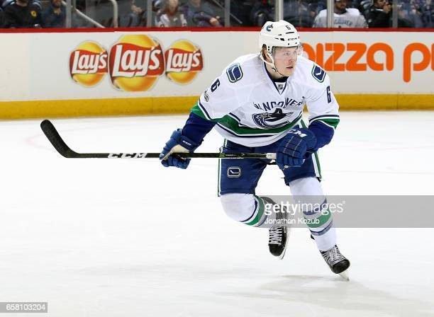 Brock Boeser of the Vancouver Canucks follows the play down the ice during first period action against the Winnipeg Jets at the MTS Centre on March...