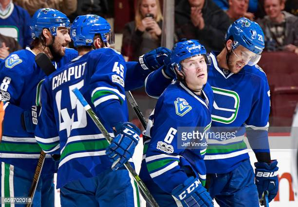 Brock Boeser of the Vancouver Canucks is congratulated by teammates Brandon Sutter Christopher Tanev and Michael Chaput after scoring during their...