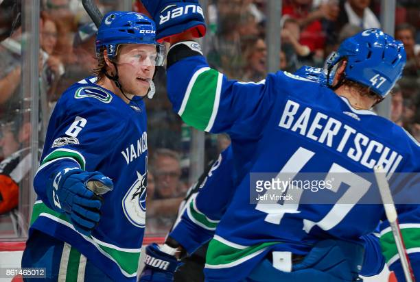 Brock Boeser of the Vancouver Canucks is congratulated by teammates after scoring during their NHL game against the Calgary Flames at Rogers Arena...