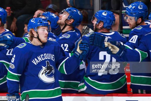 Brock Boeser of the Vancouver Canucks is congratulated by teammates after scoring during their NHL game against the Pittsburgh Penguins at Rogers...