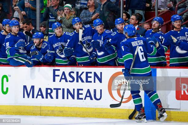 Brock Boeser of the Vancouver Canucks is congratulated by teammates after scoring his second goal during their NHL game against the Pittsburgh...