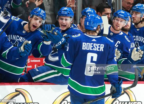 Brock Boeser of the Vancouver Canucks is congratulated by teammates after scoring a hattrick during their NHL game against the Pittsburgh Penguins at...