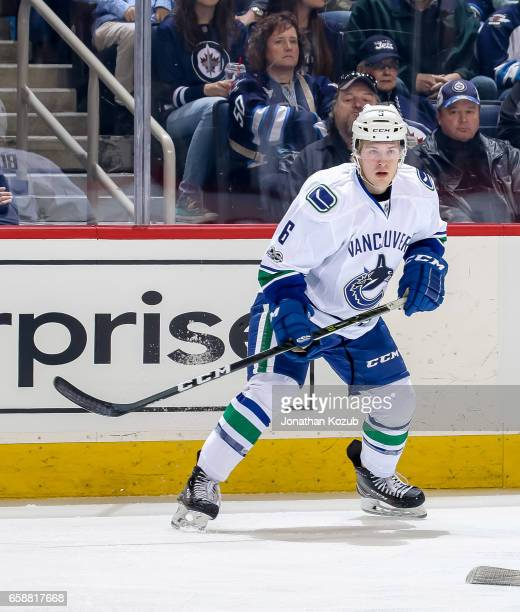 Brock Boeser of the Vancouver Canucks keeps an eye on the play during first period action against the Winnipeg Jets at the MTS Centre on March 26...