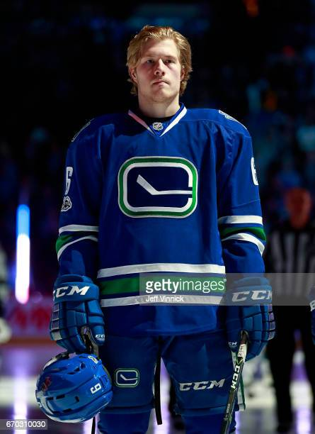 Brock Boeser of the Vancouver Canucks listens to the national anthem during their NHL game against the San Jose Sharks at Rogers Arena April 2 2017...