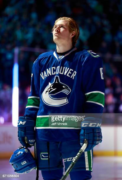 Brock Boeser of the Vancouver Canucks listens to the national anthem during their NHL game against the Los Angeles Kings at Rogers Arena March 31...