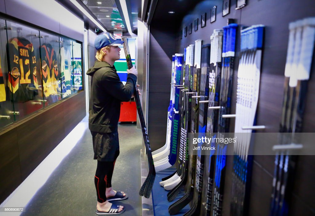 Brock Boeser #6 of the Vancouver Canucks picks out his game sticks before their NHL game against the Winnipeg Jets at Rogers Arena October 12, 2017 in Vancouver, British Columbia, Canada.