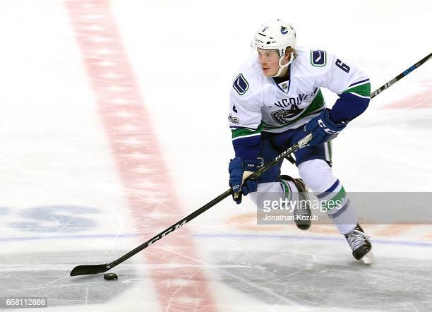 Brock Boeser of the Vancouver Canucks plays the puck down the ice during second period action against the Winnipeg Jets at the MTS Centre on March 26...
