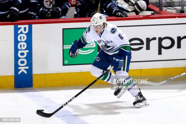 Brock Boeser of the Vancouver Canucks plays the puck up the ice during second period action against the Winnipeg Jets at the MTS Centre on March 26...