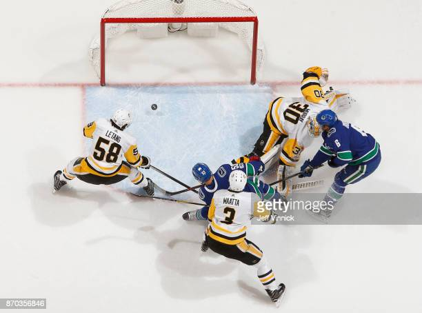 Brock Boeser of the Vancouver Canucks scores his first goal against Matthew Murray of the Pittsburgh Penguins during their NHL game at Rogers Arena...