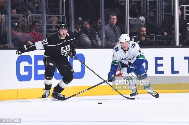Brock Boeser of the Vancouver Canucks skates against Nick Shore of the Los Angeles Kings at STAPLES Center on September 16 2017 in Los Angeles...