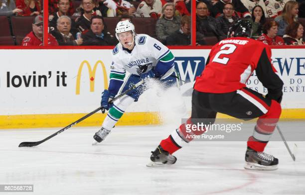 Brock Boeser of the Vancouver Canucks stickhandles the puck against Dion Phaneuf of the Ottawa Senators at Canadian Tire Centre on October 17 2017 in...