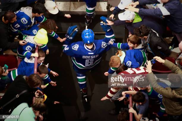 Brock Boeser of the Vancouver Canucks walks out to the ice during their NHL game against the San Jose Sharks at Rogers Arena April 2 2017 in...
