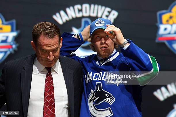 Brock Boeser poses after being selected 23th overall by the Vancouver Canucks in the first round of the 2015 NHL Draft at BBT Center on June 26 2015...