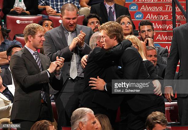 Brock Boeser reacts after being selected 23rd overall by the the Vancouver Canucks during Round One of the 2015 NHL Draft at BBT Center on June 26...