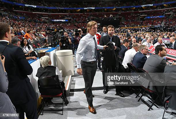 Brock Boeser walks toward the stage after being selected 23rd overall by the the Vancouver Canucks during Round One of the 2015 NHL Draft at BBT...