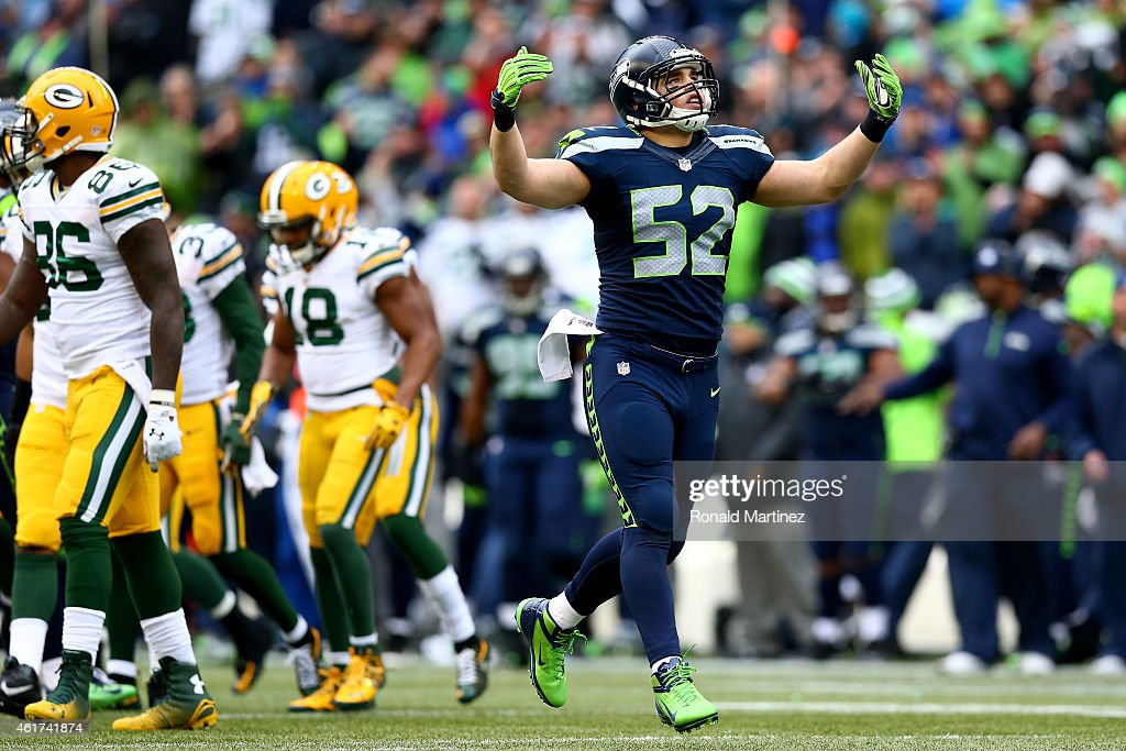 Brock Coyle #52 of the Seattle Seahawks reacts while taking on the Green Bay Packers during the 2015 NFC Championship game at CenturyLink Field on January 18, 2015 in Seattle, Washington.