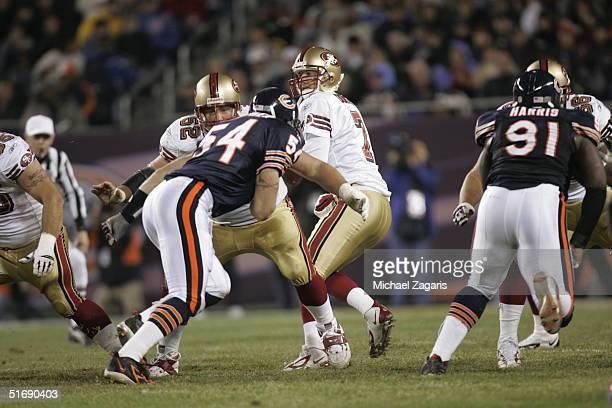 Brock Gutierrez defends for Ken Dorsey of the San Francisco 49ers against the Chicago Bears at Soldier Field on October 31 2004 in Chicago Illinois...