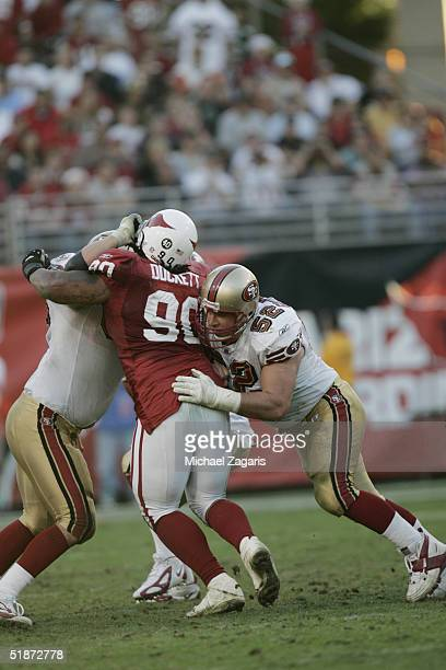Brock Gutierrez of the San Francisco 49ers defends against the Arizona Cardinals at Sun Devil Stadium on December 12 2004 in Tempe Arizona The Niners...