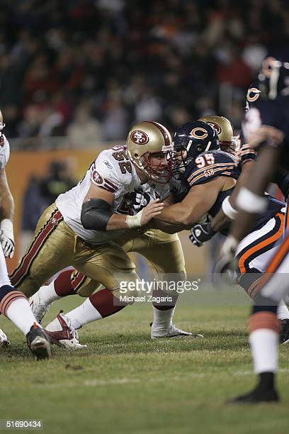 Brock Gutierrez of the San Francisco 49ers defends against the Chicago Bears at Soldier Field on October 31 2004 in Chicago Illinois The Bears...