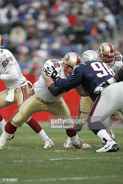 Brock Gutierrez of the San Francisco 49ers defends against the New England Patriots at Gillette Stadium on January 2 2004 in Foxborough Massachusetts...