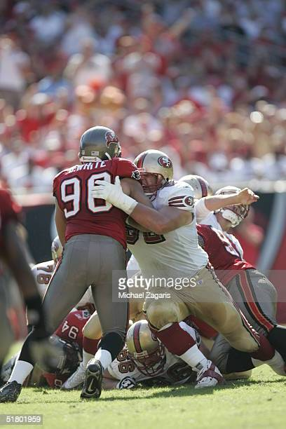 Brock Gutierrez of the San Francisco 49ers defends against the Tampa Bay Buccaneers at Raymond James Stadium on November 21 2004 in Tampa Florida The...