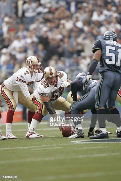 Brock Gutierrez of the San Francisco 49ers readies to block against the Seattle Seahawks before snapping the ball to Ken Dorsey at Qwest Field on...