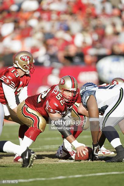 Brock Gutierrez of the San Francisco 49ers snaps the ball to Tim Rattay against the Seattle Seahawks at Monster Park on November 7 2004 in San...