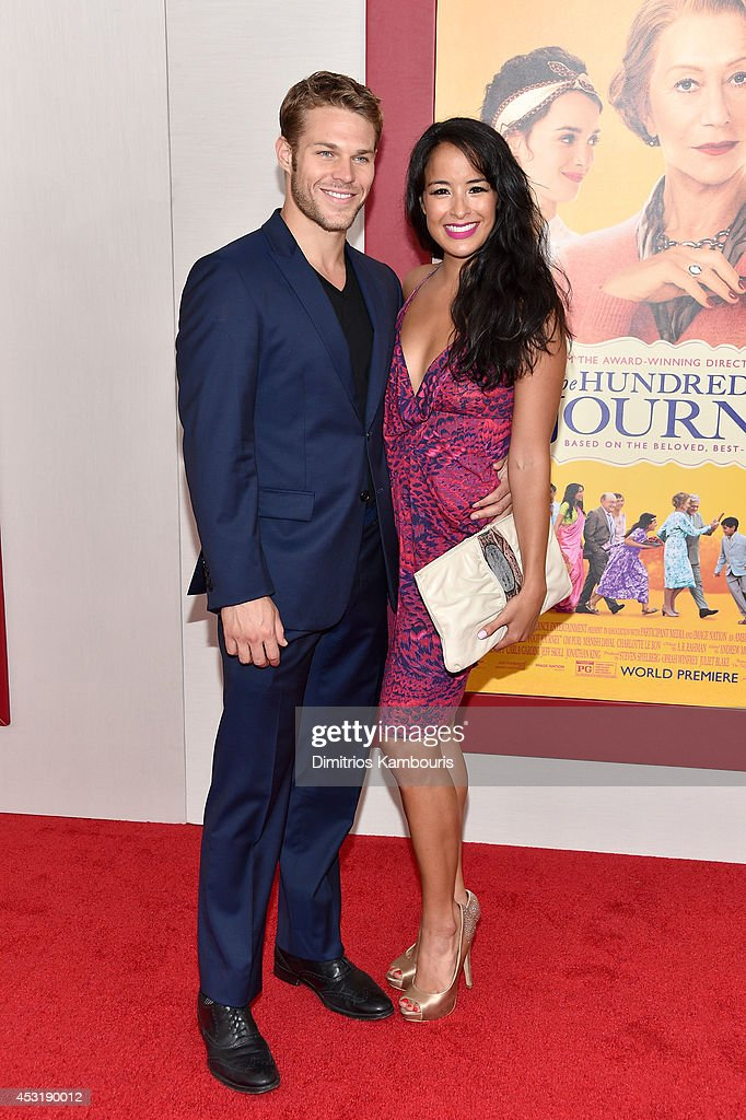 Brock Harris (L) and actress Courtney Reed attend the 'The Hundred-Foot Journey' New York premiere at Ziegfeld Theater on August 4, 2014 in New York City.