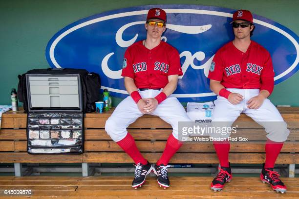 Brock Holt and Andrew Benintendi of the Boston Red Sox sit in the dugout before a game against the New York Mets on February 24 2017 at Fenway South...