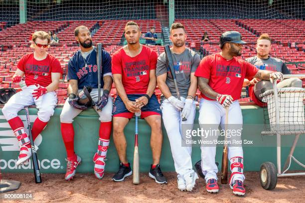 Brock Holt Chris Young Xander Bogaerts Deven Marrero Pablo Sandoval and Christian Vazquez of the Boston Red Sox lean against the wall during a...