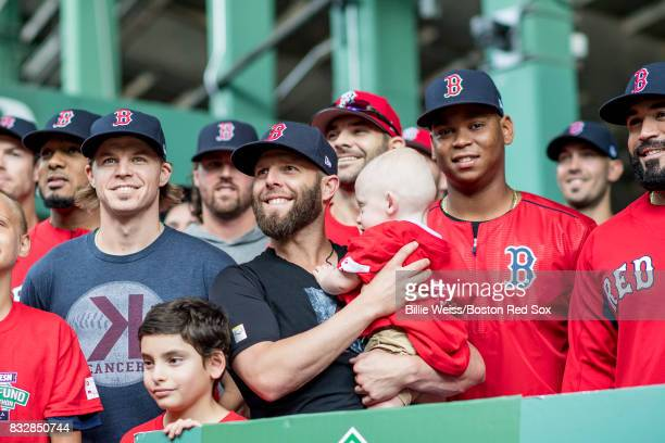 Brock Holt Dustin Pedroia and Rafael Devers of the Boston Red Sox pose for a photograph with a Jimmy Fund patient during the 2017 WEEINESN Jimmy Fund...