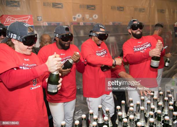 Brock Holt Jackie Bradley Jr #19 Mookie Betts and Deven Marrero of the Boston Red Sox prepare to pop bottles after clinching the American League East...