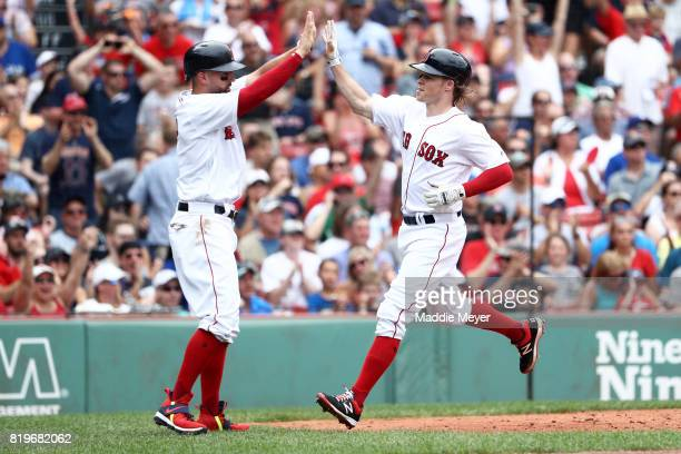 Brock Holt of the Boston Red Sox and Deven Marrero celebrate after scoring runs against the Toronto Blue Jays during the second inning at Fenway Park...
