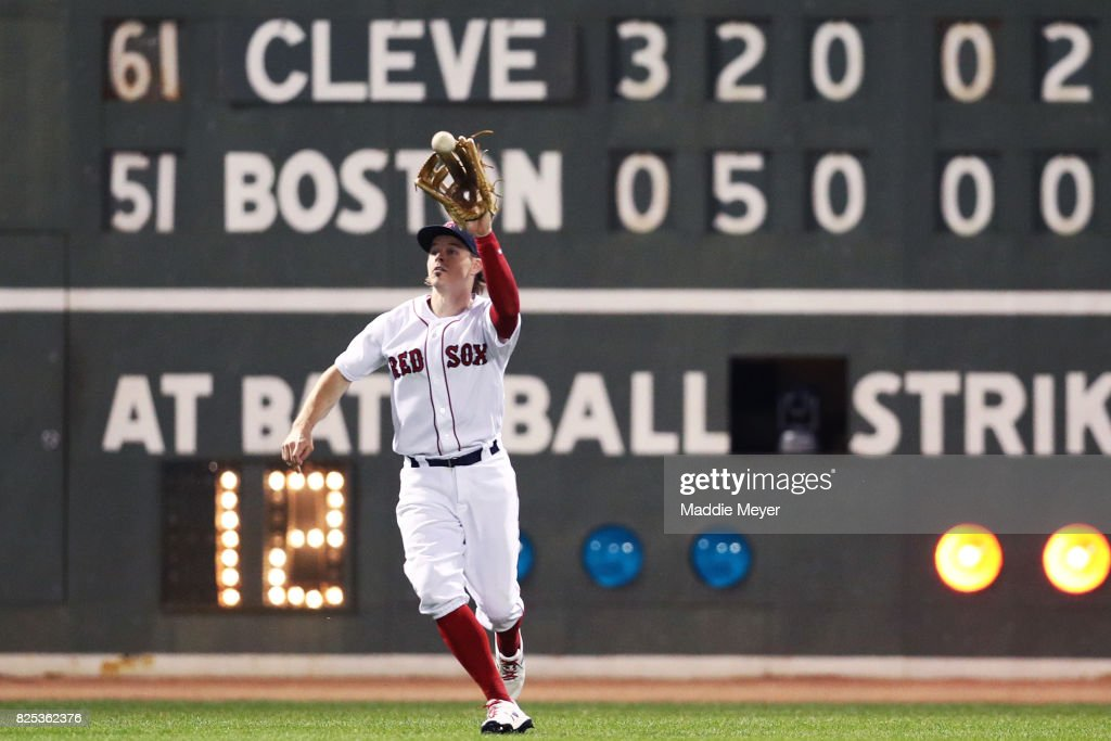 Brock Holt #12 of the Boston Red Sox catches a fly ball hit by Francisco Lindor #12 of the Cleveland Indians during the sixth inning at Fenway Park on August 1, 2017 in Boston, Massachusetts.