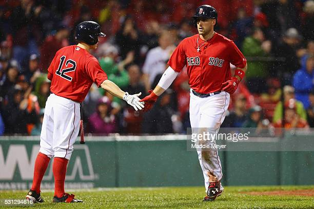 Brock Holt of the Boston Red Sox congratulates Travis Shaw after he hit a home run against the Houston Astros during the sixth inning on May 13 2016...