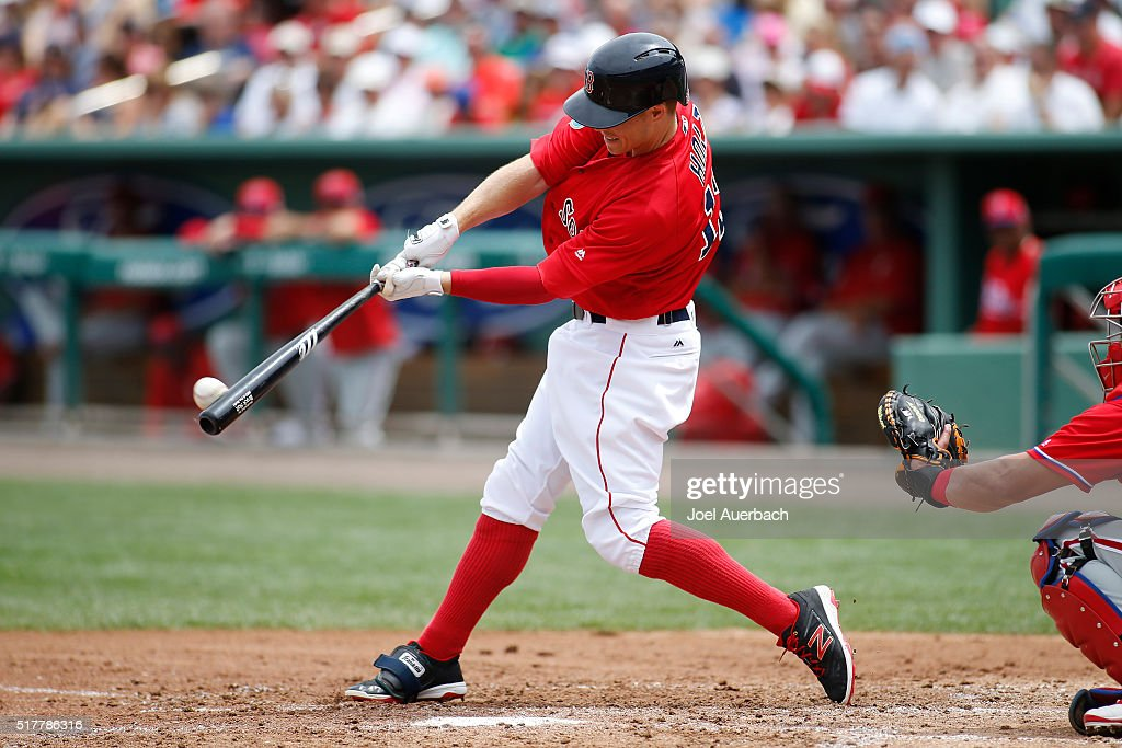 Brock Holt #12 of the Boston Red Sox doubles against the Philadelphia Phillies during th second inning of a spring training game at JetBlue Park on March 27, 2016 in Fort Myers, Florida. The Red Sox defeated the Phillies 5-1.
