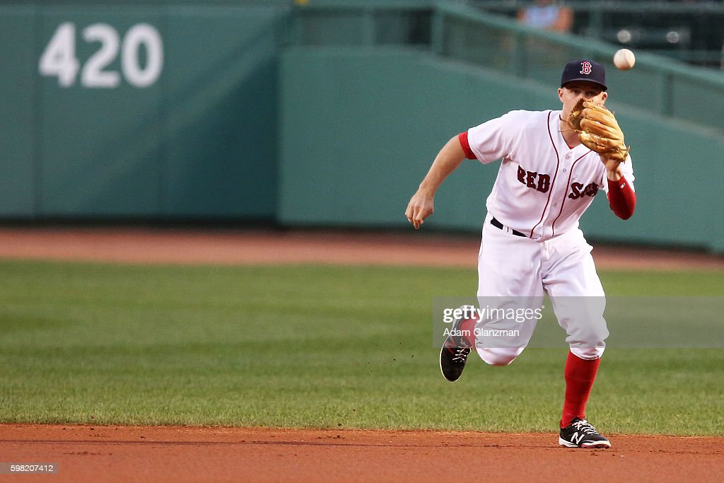 Brock Holt of the Boston Red Sox fields a ball in the first inning during a game against the Tampa Bay Rays at Fenway Park on August 29 2016 in...